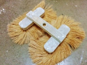 Top view of a double crows foot stomp brush used for drywall texture