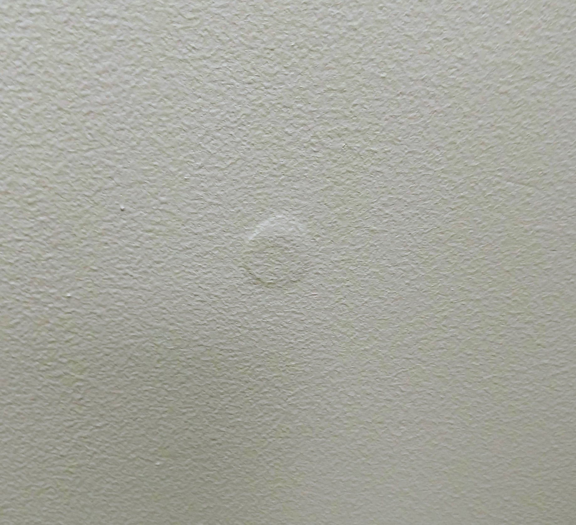 Picture Of A Loose In Drywall Causing The Paint To