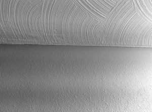Photo of swirl drywall texture on the ceiling and knockdown texture on the wall